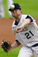 Colorado Rockies starting pitcher Kyle Freeland throws against the San Francisco Giants during the first inning of a baseball game, Thursday, Aug. 6, 2020, in Denver. (AP Photo/Jack Dempsey)