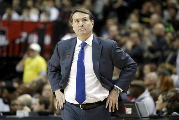 Saint Louis head coach Travis Ford looks on during the first half of an NCAA college basketball final game against St. Bonaventure in the Atlantic 10 men's tournament, Sunday, March 17, 2019, in New York. (AP Photo/Julio Cortez)