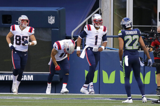 New England Patriots quarterback Cam Newton (1) celebrates after he scored a touchdown against the Seattle Seahawks during the first half of an NFL football game, Sunday, Sept. 20, 2020, in Seattle. (AP Photo/John Froschauer)