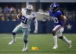 Dallas Cowboys running back Ezekiel Elliott (21) runs the ball as New York Giants cornerback Janoris Jenkins (20) defends in the first half of a NFL football game in Arlington, Texas, Sunday, Sept. 8, 2019. (AP Photo/Ron Jenkins)