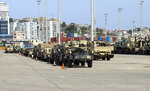 U.S. military vehicles are parked at an area of Albania's main port of Durres, Saturday, May 1, 2021.  Florida National Guard's 53rd Infantry Brigade Combat Team were being discharged from the USNS Bob Hope ahead of a two-week training of up to 6,000 U.S. troops in six Albanian military bases, as part of the Defender-Europe 21 large-scale U.S. Army-led exercise. (AP Photo/Hektor Pustina)