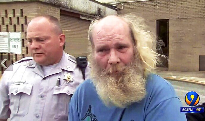 This photo from video provided by WSOC-TV shows suspect Edwin Hiatt after his arrest Thursday, May 9, 2019, in Burke County, N.C. Hiatt is charged with bludgeoning and strangling to death a Hollywood TV director more than three decades ago. Authorities say the FBI arrested Hiatt after DNA evidence linked him to the 1985 death of Barry Crane in Los Angeles. (WSOC-TV via AP)