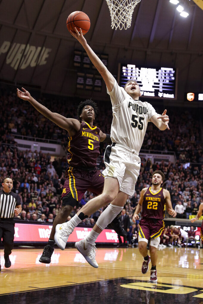 Purdue guard Sasha Stefanovic (55) shoots in front of Minnesota guard Marcus Carr (5) during the second half of an NCAA college basketball game in West Lafayette, Ind., Thursday, Jan. 2, 2020. Purdue won 83-78 in double overtime. (AP Photo/Michael Conroy)