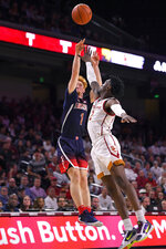Arizona guard Nico Mannion, left, shoots as Southern California guard Jonah Mathews defends during the second half of an NCAA college basketball game Thursday, Feb. 27, 2020, in Los Angeles. USC won 57-48. (AP Photo/Mark J. Terrill)