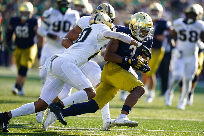 Purdue safety Cam Allen (10) tackles Notre Dame wide receiver Avery Davis (3) during the second half of an NCAA college football game in South Bend, Ind., Saturday, Sept. 18, 2021. Notre Dame defeated Purdue 27-13. (AP Photo/Michael Conroy)