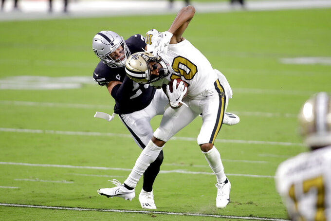 New Orleans Saints wide receiver Tre'Quan Smith (10) breaks a tackle from Las Vegas Raiders free safety Erik Harris during the first half of an NFL football game, Monday, Sept. 21, 2020, in Las Vegas. (AP Photo/Isaac Brekken)