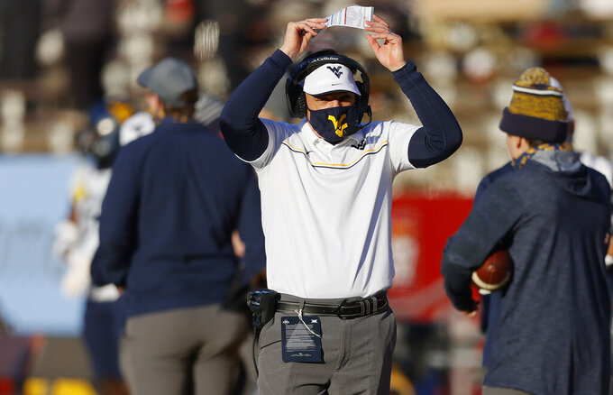 West Virginia head coach Neal Brown reacts after his team was stopped short of a first down during the first half of an NCAA college football game against Iowa State, Saturday, Dec. 5, 2020, in Ames, Iowa. (AP Photo/Matthew Putney)