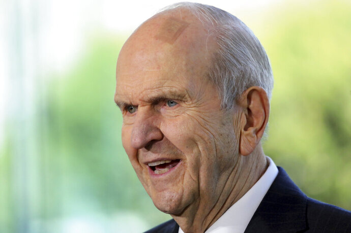 FILE - In this April 19, 2019 file photo The Church of Jesus Christ of Latter-day Saints President Russell M. Nelson speaks during a news conference at the Temple Square South Visitors Center in Salt Lake City. The Church of Jesus Christ of Latter-day Saints' top leader has been invited to speak at the NAACP convention in Detroit, marking the latest sign of a burgeoning partnership between the two organizations. The Utah-based faith said in a news release Wednesday, July 17, 2019, that Nelson will speak Sunday. (AP Photo/Rick Bowmer, File)