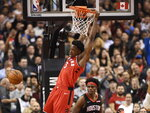Toronto Raptors forward OG Anunoby (3) dunks in front of Houston Rockets forward Danuel House Jr. (4) during second half NBA action in Toronto on Thursday, Dec.5, 2019. (Nathan Denette/The Canadian Press via AP)