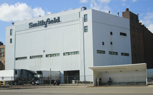 FILE - This April 8, 2020 file photo, shows the Smithfield pork processing plant in Sioux Falls, S.D. The union representing employees at the South Dakota pork processing plant says it will partially reopen on Monday, May 4, 2020, after shuttering more than two weeks ago because of a coronavirus outbreak that infected hundreds of employees. (AP Photo/Stephen Groves File)