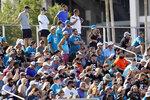 Fans pack bleachers as they watch the Jacksonville Jaguars NFL football practice, Saturday, July 31, 2021, in Jacksonville, Fla. (AP Photo/John Raoux)