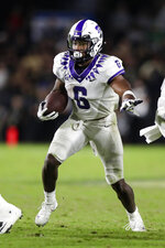 TCU running back Darius Anderson runs against Purdue during the second half of an NCAA college football game in West Lafayette, Ind., Saturday, Sept. 14, 2019. (AP Photo/Michael Conroy)