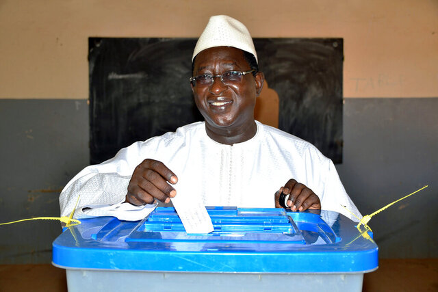 FILE - In this Aug. 12, 2018 file photo released by the Union for the Republic and Democracy party shows then opposition Presidential candidate Soumaila Cisse casting his ballot during the presidential second round election in Niafunke, Mali. Malian opposition leader Soumaila Cissé, who was held hostage for six months by jihadists and considered a leading contender for 2022 elections, has died in Paris, his family said Friday. (Boubacar Sada Sissoko/Union for the Republic and Democracy via AP, File)