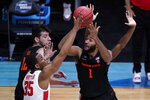 Oregon State forward Maurice Calloo (1) shoots on Houston forward Fabian White Jr. (35) during the first half of an Elite 8 game in the NCAA men's college basketball tournament at Lucas Oil Stadium, Monday, March 29, 2021, in Indianapolis. (AP Photo/Darron Cummings)