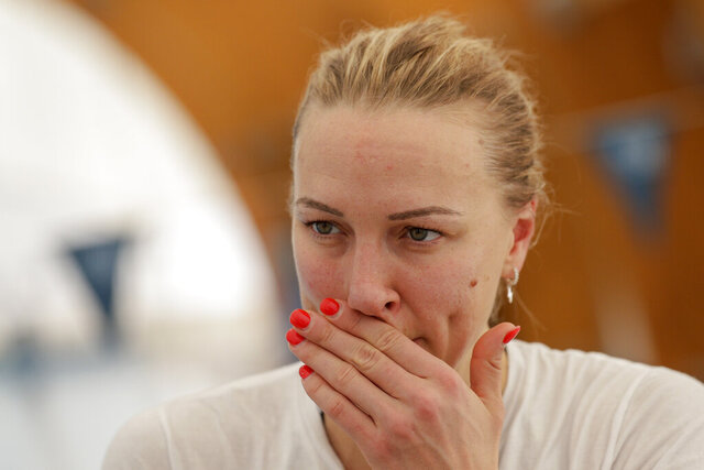 Swedish swimmer Sarah Sjöström listens to questions during an interview with The Associated Press, in Naples, Wednesday, Feb. 26, 2020. If any thoughts were creeping into their minds that the Tokyo Olympics might be canceled due to a viral outbreak, elite swimmers Katinka Hosszú, Chad le Clos and Sarah Sjöström certainly didn't show it during a strenuous two-hour training session Wednesday.(AP Photo/Andrew Medichini)