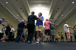 This July 4, 2019 photo shows dancers move around the floor during the International Association of Gay Square Dance Clubs  annual convention in Philadelphia. The Independence Squares were founded 30 years ago in part as a social outlet for the LGBTQ community.  (AP Photo/Jacqueline Larma)