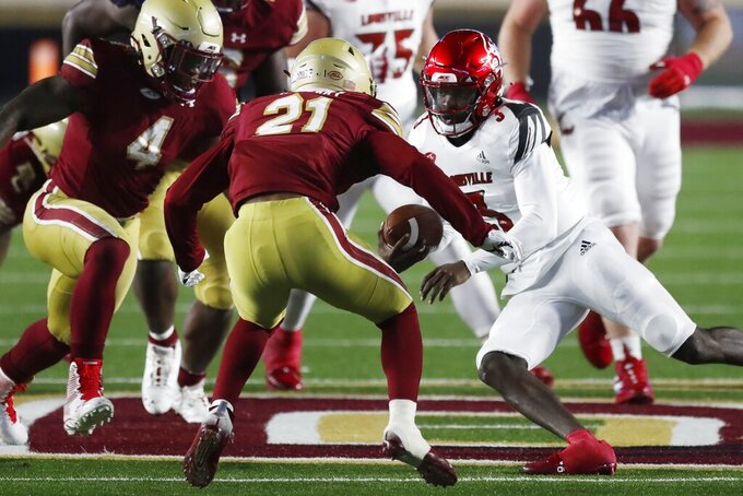 Louisville quarterback Malik Cunningham (3) carries the ball against Boston College defensive back Josh DeBerry (21) during the second half of an NCAA college football game, Saturday, Nov. 28, 2020, in Boston. (AP Photo/Michael Dwyer)