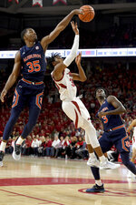 Auburn defender Devan Cambridge (35) blocks the shot of Arkansas forward Jimmy Whitt Jr. (33) during the first half of an NCAA college basketball game Tuesday, Feb. 4, 2020, in Fayetteville, Ark. (AP Photo/Michael Woods)