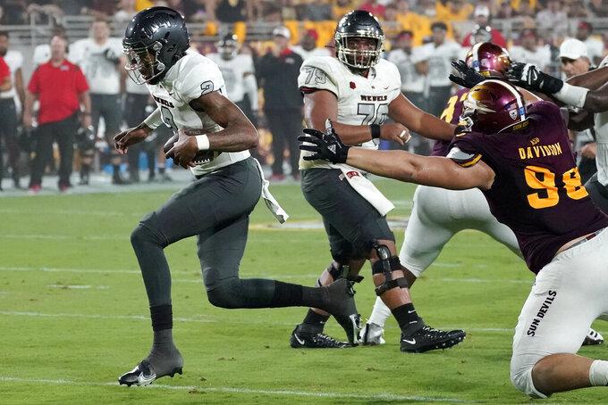 UNLV quarterback Doug Brumfield (2) runs for a touchdown against Arizona State during the first half of an NCAA college football game, Saturday, Sept. 11, 2021, in Tempe, Ariz. (AP Photo/Matt York)