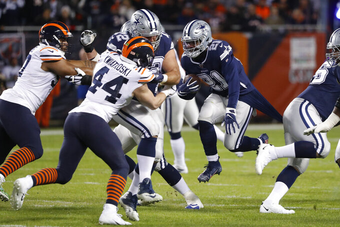 Dallas Cowboys' Ezekiel Elliott (21) runs during the first half of an NFL football game against the Chicago Bears, Thursday, Dec. 5, 2019, in Chicago. (AP Photo/Charles Rex Arbogast)