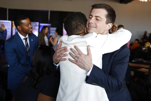 Democratic presidential candidate former South Bend Mayor Pete Buttigieg embraces Hannah Brown at the Nevada Black Legislative Caucus Black History Awards brunch Sunday, Feb. 16, 2020, in Las Vegas. (AP Photo/John Locher)