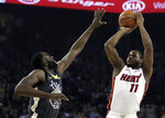 Miami Heat guard Dion Waiters, right, shoots against Golden State Warriors' Draymond Green, left, during the first half of an NBA basketball game, Sunday, Feb. 10, 2019, in Oakland, Calif. (AP Photo/Ben Margot)