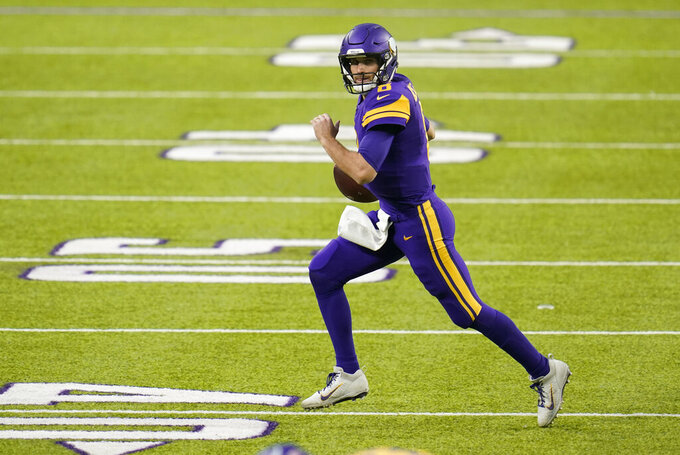 Minnesota Vikings quarterback Kirk Cousins (8) looks to pass during the first half of an NFL football game against the Dallas Cowboys, Sunday, Nov. 22, 2020, in Minneapolis. (AP Photo/Jim Mone)