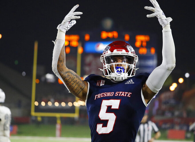 Fresno State wide receiver Jalen Cropper celebrates one of four touchdowns over UNLV during the second half of an NCAA college football game in Fresno, Calif., Friday, Sept. 24, 2021. (AP Photo/Gary Kazanjian)