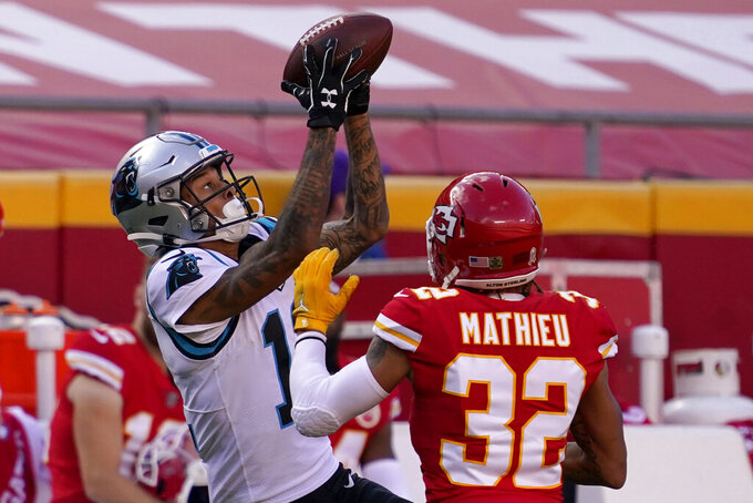 Carolina Panthers wide receiver Robby Anderson, left, catches a pass against Kansas City Chiefs strong safety Tyrann Mathieu (32) during the second half of an NFL football game in Kansas City, Mo., Sunday, Nov. 8, 2020. (AP Photo/Jeff Roberson)
