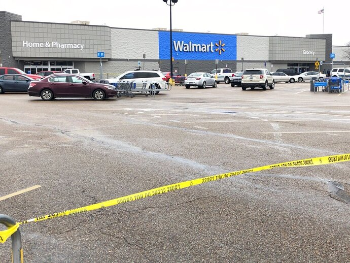 Police tape blocks off a Walmart store parking lot in Forrest City, Ark., on Monday, Feb. 10, 2020. Police say at least three people, including two officers, have been shot this Walmart in eastern Arkansas. (AP Photo/Adrian Sainz)