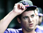 Colorado Rockies starting pitcher Peter Lambert (23) gestures in the dugout after completing the seventh inning of a baseball game against the Chicago Cubs, Thursday, June, 6, 2019, in Chicago. (AP Photo/David Banks)