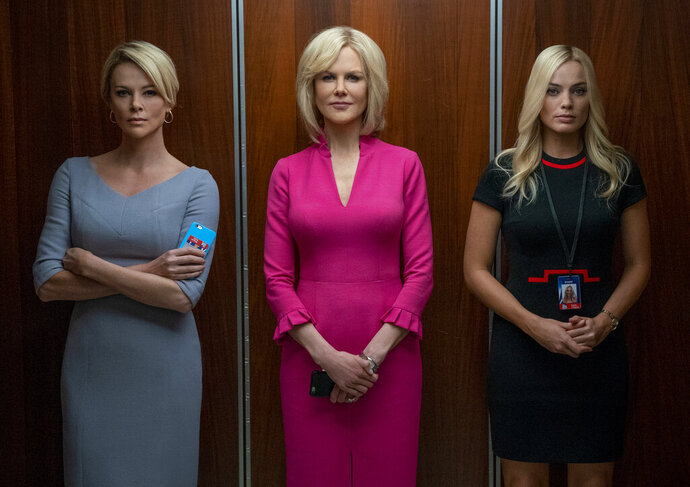 This image released by Lionsgate shows Charlize Theron, from left, Nicole Kidman and Margot Robbie in a scene from
