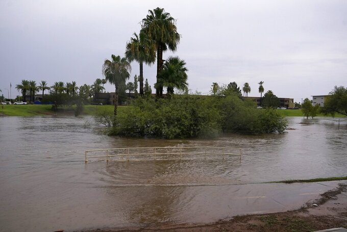 Heavy rains caused flooding at Vista del Camino Park, Friday, July 23, 2021, in Scottsdale, Ariz. (AP Photo/Ross D. Franklin)