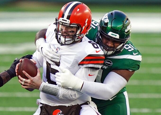 FILE - In this Dec. 27, 2020, file photo, New York Jets defensive end John Franklin-Myers (91) sacks Cleveland Browns quarterback Baker Mayfield (6) during the first half of an NFL football game in East Rutherford, N.J. The Jets and Franklin-Myers agreed to terms on a four-year contract extension Thursday, Oct. 7, 2021, according to a person with direct knowledge of the deal. The person spoke to The Associated Press on condition of anonymity because the team had not announced the extension, which was first reported by the New York Daily News. (AP Photo/Corey Sipkin, File)
