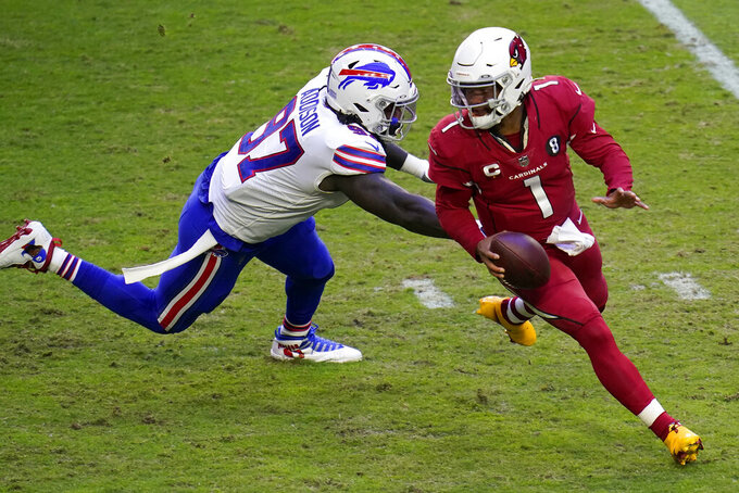 Arizona Cardinals quarterback Kyler Murray (1) runs as Buffalo Bills defensive end Mario Addison (97) defends during the first half of an NFL football game, Sunday, Nov. 15, 2020, in Glendale, Ariz. (AP Photo/Ross D. Franklin)
