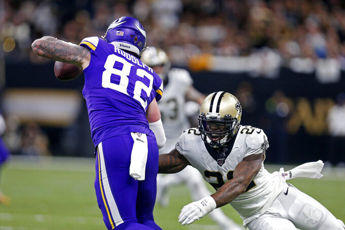 New Orleans Saints defensive back Chauncey Gardner-Johnson (22) tries to tackle Minnesota Vikings tight end Kyle Rudolph (82) in the first half of an NFL wild-card playoff football game, Sunday, Jan. 5, 2020, in New Orleans. (AP Photo/Butch Dill)