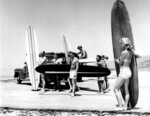 FILE - In this July 12, 1961 file photo members of the North Bay surfing club upload their surf boards from a station wagon at Malibu Beach, Calif, California Gov. Jerry Brown announced Monday, Aug. 20, 2018 that he signed a bill making surfing the official state sport. (AP Photo,File)