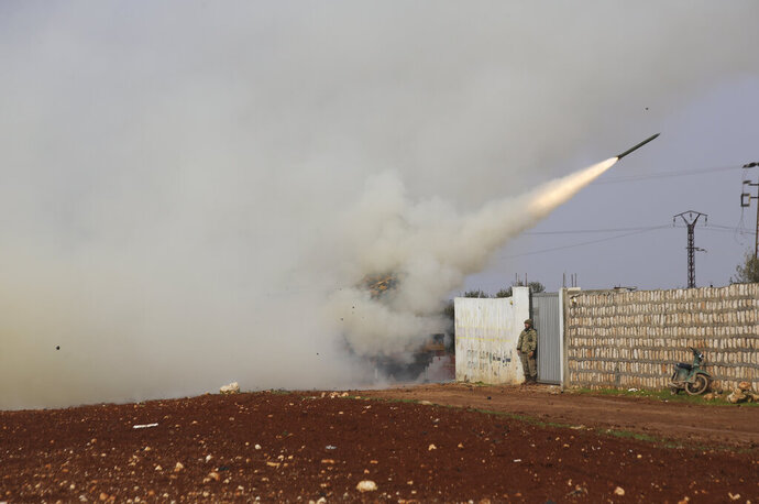Turkish soldiers fire a missile at Syrian government position in the province of Idlib, Syria, Friday, Feb. 14, 2020. Turkey, backer of Syria's opposition, has been deploying equipment and troops in the region, which is home to more than 3 million people, in an attempt to halt the Syrian military's advances. (AP Photo/Ghaith Alsayed)