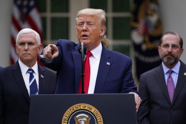 President Donald Trump takes questions during a news conference about the coronavirus in the Rose Garden of the White House, Friday, March 13, 2020, in Washington. Vice President Mike Pence, left, and Department of Health and Human Services Secretary Alex Azar, right listen. (AP Photo/Evan Vucci)