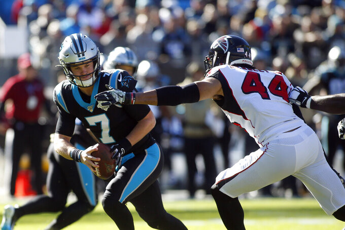 Carolina Panthers quarterback Kyle Allen (7) scramles while Atlanta Falcons defensive end Vic Beasley (44) rushes during the first half of an NFL football game in Charlotte, N.C., Sunday, Nov. 17, 2019. (AP Photo/Brian Blanco)