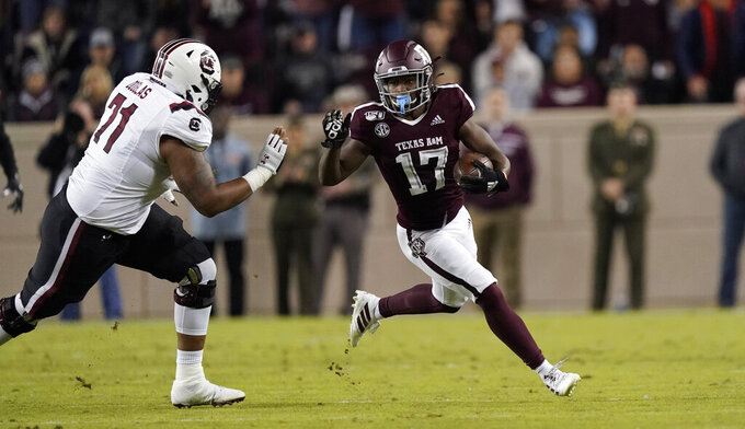Texas A&M wide receiver Ainias Smith (17) returns a punt as South Carolina offensive lineman Eric Douglas (71) defends during the second quarter of an NCAA college football game Saturday, Nov. 16, 2019, in College Station, Texas. (AP Photo/David J. Phillip)