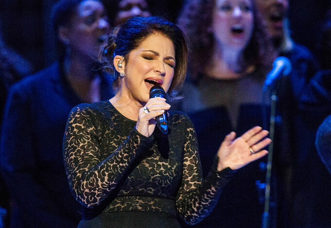 """FILE - Gloria Estefan sings """"Mas Alla"""" prior to Pope Francis celebrating Mass in New York on Sept. 25, 2015. Estefan said she's emerging from isolation after testing positive for COVID-19, days after dining outdoors at a Miami-area restaurant. Estefan says she fortunately only lost her sense of smell and taste and had """"a little bit of a cough"""" and dehydration. In a video shared on Instagram, she says she's since tested negative.(Andrew Burton/Pool Photo via AP)"""