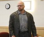 Max Misch, a self-described white nationalist, walks out of the Bennington County courtroom, Thursday afternoon, Feb. 7, 2019, in Bennington, Vt. Misch, who has harassed Vermont's only female black legislator who later resigned, pleaded not guilty on Thursday to two counts of possessing illegal, large capacity gun magazines. (Holly Pelczynski/The Banner via AP)