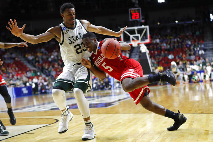 Bradley guard Darrell Brown (5) drives past Michigan State forward Xavier Tillman during a first round men's college basketball game in the NCAA Tournament, Thursday, March 21, 2019, in Des Moines, Iowa. Michigan State won 76-65. (AP Photo/Charlie Neibergall)