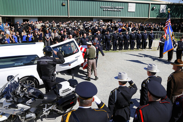 FILE - In this March 31, 2017 file photo, people fill the high school's Darrell James gymnasium in the tiny town of Canadian to pay last respects to Tecumseh police officer Justin Terney. A jury has recommended a death sentence for a man convicted of fatally shooting Terney in central Oklahoma following a 2017 traffic stop. District Attorney Greg Mashburn says the Pottawatomie County jury on Friday, Nov. 22, 2019, recommended Byron James Shepard be sentenced to die for the shooting death of officer Terney. (Jim Beckel,/The Oklahoman via AP File)