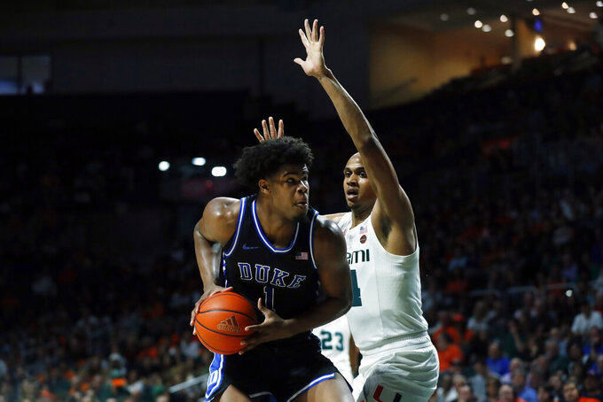 Duke forward Vernon Carey Jr. (1) looks for an opening past Miami center Rodney Miller Jr. (14) during the second half of an NCAA college basketball game, Saturday, Jan. 4, 2020, in Coral Gables, Fla. (AP Photo/Wilfredo Lee)