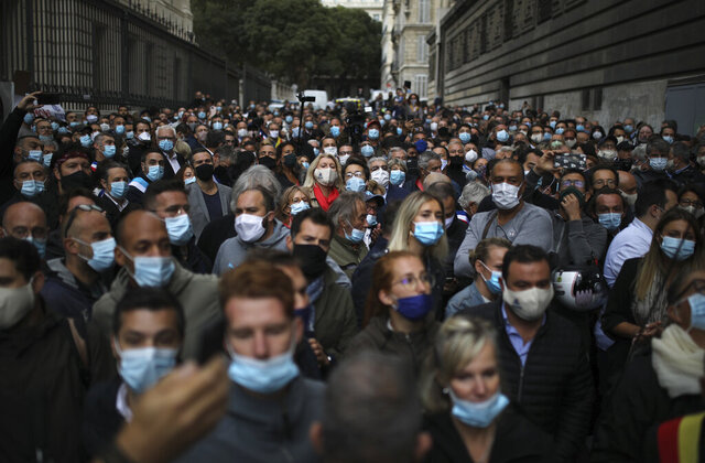 Angry restaurant and bar owners demonstrate in Marseille, southern France, Friday Sept. 25, 2020 to challenge a French government order to close all public venues as of Saturday to battle resurgent virus infections. The protesters, and local officials in France's second-biggest city, are also threatening legal action, to try to block the order via the courts. They argue that Marseille's virus case rise has been stabilizing, and that the central government in Paris is unfairly singling out Marseille for the toughest virus measures in the nation. (AP Photo/Daniel Cole)