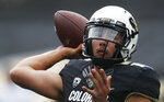 Colorado quarterback Steven Montez warms up before an NCAA college football game against Arizona State, Saturday, Oct. 6, 2018, in Boulder, Colo. (AP Photo/David Zalubowski)