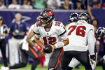 FILE - In this Saturday, Aug. 28, 2021, file photo, Tampa Bay Buccaneers quarterback Tom Brady (12) hands off the ball during the first half of a preseason NFL football game against the Houston Texans in Houston. (AP Photo/Justin Rex, File)