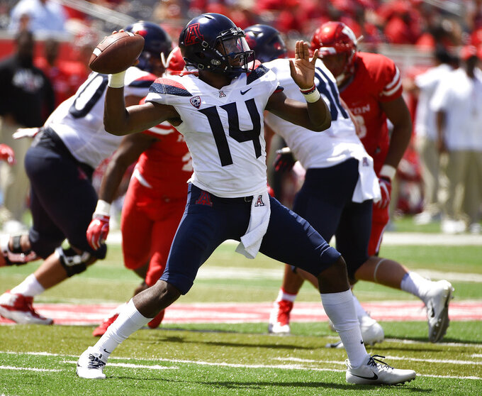 Arizona quarterback Khalil Tate (14) drops back to pass during the second half of an NCAA college football game against Houston, Saturday, Sept. 8, 2018, in Houston. (AP Photo/Eric Christian Smith)